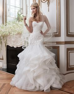 Justin Alexander wedding dresses style 8795 Laser cut embroidered satin, tulle and Organza fit and flare highlighted by a sweetheart neckline.