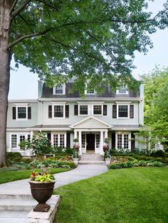 Oh my goodness!  This house is very similar to ours - except for the fantastic landscaping!  Love the paint color and the rounded dormer windows -- will have to update both.