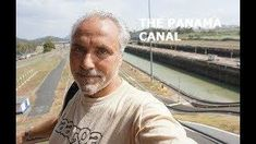 THE PANAMA CANAL huge CARGO SHIP crossing and LOCOMOTIVES guiding it through