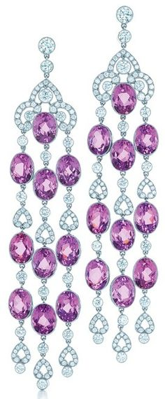 Kunzite and diamond earrings from the 2013 Tiffany and Co Blue Book. Kunzite embellishes diamonds with the lure of lilacs at the garden gate. Found in California and introduced by Tiffany in 1902. These drop earrings feature 20 oval kunzites, diamonds and platinum. Via Tiffany & Co.