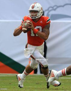 News Photo : Malik Rosier of the Miami Hurricanes looks to...