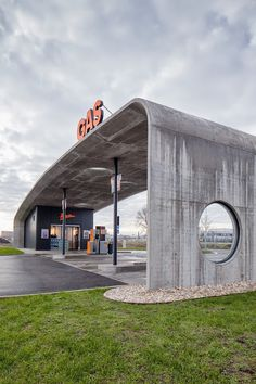 minimalist structure devised by Czech firm Atelier SAD | Completed late last year in the southern Slovakian city of Dunajská Streda, this gas station is capped with a thin swoosh of concrete, a raw but refined piece of roadside infrastructure that creates a simple shelter for motorists with a minimum of materials.