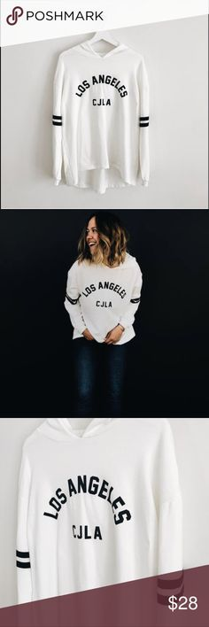 Carly Jean Los Angeles brand hoodie Worn a few times.  So soft and stretchy. Has a hood. No pockets. White and Black colors. FTTS  Cleaning out my closet a bit. Carly Jean Los Angeles Sweaters Crew & Scoop Necks