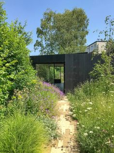 As its name suggests, the Dark Spa was designed to contrast to the extension's pale brick exterior, and is clad in charred black timber. Garden In The Woods, House In The Woods, Fresco, Brick Extension, Charred Wood, Arch House, Timber Cladding, London House, Roof Light