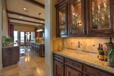 BUTLER'S PANTRY Strategically situated between the Dining Room & the Kitchen to facilitate efficient service when entertaining.  Built-in cabinetry beautifully displays your crystal & keeps it readily available.
