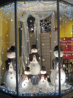 lets put snowman heads on our mannequins in our windows. we can draw FIERCE faces on them