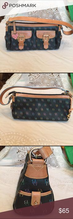 Authentic Dooney & Bourke Purse Handbag is in good used condition. Some makeup on lining and a small watermark on strap, otherwise excellent. Very cute and colorful with even the zipper multicolored. No rips, tears, or cracking. Dooney & Bourke Bags Shoulder Bags