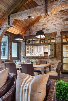 Lovely cabin! Stone walls, beams...wonderful dining space.