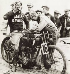 July 1925: Joe Petrali in the pits at the AMA 100-mile championship in Altoona, Penn. Petrali had been set to race for Indian that day, but they'd shipped his bike to Pittsburg. A distraught Petrali was forced to watch until Ralph Hepburn crashed during practice. Unable to ride himself, Hepburn offered Petrali his H-D two cam bike if he agreed to split his winnings. Petrali agreed and won, setting an unbroken board track record of 100.36 mph.