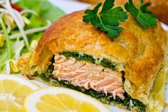 Rachael Ray shared her puff pastry idea for a Garlic-Herb Salmon en Croute Recipe, served with a custom herb blend and a Fennel Cucumber Salad on the side. Healthy Salmon Recipes, Fish Recipes, Lunch Recipes, Seafood Recipes, Salad Recipes, Dinner Recipes, Seafood Dishes, Vegan Recipes, Party Dishes