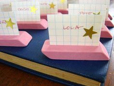 eraser place cards for the first day of school! use an exacto knife to slit the eraser.