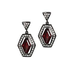 Earrings in silver with black rhodium with 2.6 cts. t.w. red garnet and 0.33 ct. t.w. diamonds, $1,500; Mayson