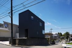the same galvanized panel used for factories and warehouses has been used in the striking exterior of this family home.