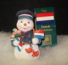 A ceramic snowman, hoding the Dutch flad & bouquet of ulips