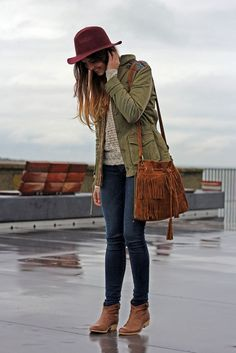 dark skinnies, a beige sweater, an olive green jacket and ankle boots