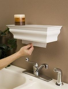This crown molding shelf hides your paper towels.