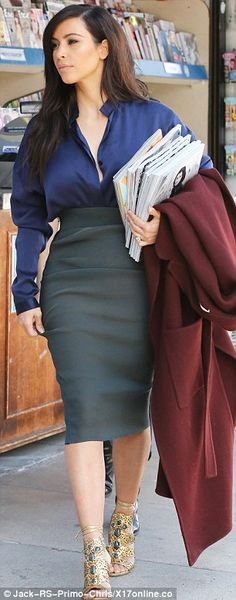Dressed for winter Kim? The reality star arrived in a snug coat, despite the balmy tempera... http://dailym.ai/1mwoAmG#i-a7a60e63