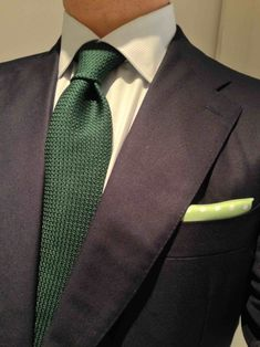 Navy suit, white shirt, hunter green tie, and lime colored pocket square. Take a close look at the fabric textures. Nicely done