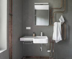 exposed plumbing copper pipes as architectural feature bathroom sink