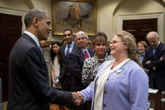 Deb Carey, co-founder of the New Glarus Brewery, meets President Obama (even the President loves our beer!)