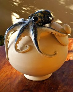 """Octopod"" a gorgeous ceramic piece by Glen MacInnis. A bit whimsical with the octopus taking the lid off the jar. see more - you'll be glad...  www.macinnispottery.com/gallery.html"