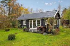 Summerhouse in Denmark with 463 sq ft of inside space. It has two small bedrooms plus a sleeping loft.   www.facebook.com/SmallHouseBliss