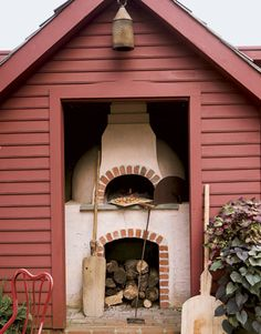 Connecticut Country HomeOutdoor Pizza Oven  Most cooking takes place outdoors, thanks to an Italian wood-burning pizza oven, a stone grill for paella, a fire pit for roasting marshmallows, and a brick built-in barbecue with a rotisserie.
