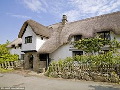 Robert Southey lived with his wife Edith in the picture-postcard Burton Cottage in Burton, Dorset, from 1799 to when he was in his The cottage is currently on the market for million. Inglenook Fireplace, Rich Home, Thatched Roof, Picture Postcards, Village Houses, Exposed Beams, Decoration, Townhouse, House Styles