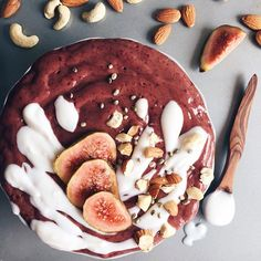 Plum Acai bowl with coconut yogurt, figs and nuts