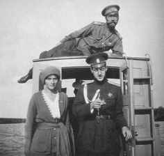 "Tatiana, Dmitri Pavlovich, & Nicholas - Mogilev, 1915. ""Repinned by Keva xo""."