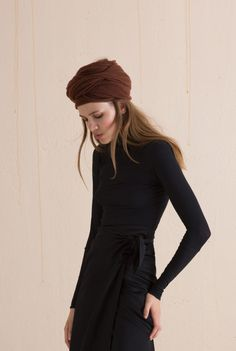 Shop the Black stretch silk jersey turtleneck top. This top is perfect to wear under other garments for extra warmth, and has long sleeves with a double cuff. Ready-to-wear with an artisanal touch, crafted in Barcelona with Italian fabric.