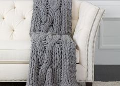 Nothing compares to the comfy feel of your favorite chunky knit sweater—until now. Our super-chunky wool/acrylic cross cable knit throw is beautifully crafted and is slightly overscale for supersize c