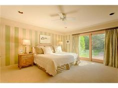 A spacious bedroom with striped paint