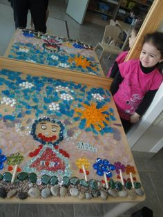 Wow! Look at the beautiful picture she made with loose parts. Love the mirror behind too! - at Reggio Kids Childcare Centres