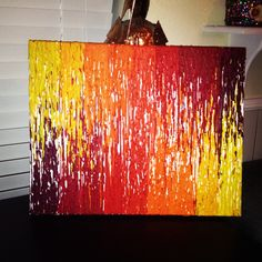 SERIOUS melted crayon canvas - LOVE THIS.  Definitely doing this.