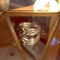 Celtic Ring Celtic styled ring size 8! This ring is sterling silver and is mildly tarnished but should be easy to clean with a silver rag. Jewelry Rings
