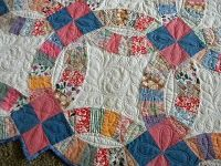 feather in wedding ring quilt
