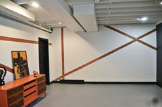 Wood Accent Wall - graphin wall-accents created with vinyl floor planks.