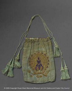 This victorian reticule was made in India. It is slightly stained but the three peacocks in the centre are still displaying their golden wings. The green cords with green and gold tassels match the colour of the body perfectly well.