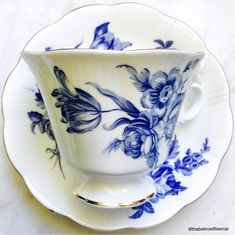 Elegant blue and white floral Royal Albert tea cup and saucer featuring a pedestal base and fancy handle in the Gainsborough shape. Set is in excellent antique condition. ~~~~~~~~~~~~~~~~~~~~~~~~~~~~~~~~~~~~~~~~~~~~~~~~~ ~Complimentary antique sugar spoon included with every