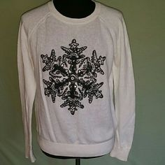 H & M holiday sweater H & M cream colored holiday sweater with a black snowflake, size small. Very cool and chic!! H&M Sweaters Crew & Scoop Necks