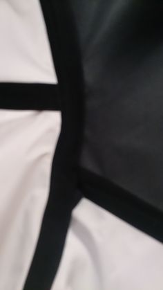 wrong side of jacket showing the hot taping at the seams