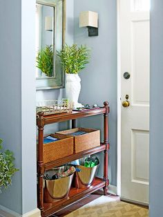 Think small and incorporate a narrow console table like the one shown here. fill the shelves with decorative storage baskets and Decor, Home, Small Spaces, Small Entryways, Living Room Makeover, Hallway Storage, Relaxing Living Room, Room Makeover, Wooden Shelving Units