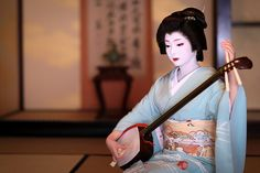 The geiko Toshimana playing shamisen. She would be so goal if i was a geisha, I mean look how amazing and gentle she looks! (Source)