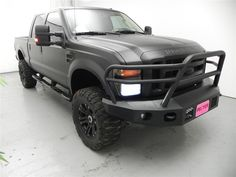 This truck has been drooled over more than any other used truck I have seen in a long time. 2009 Ford F250 Matte Black with a brush guard and rear bumper that takes no prisoners. Bring a towel if you come to drive this bad boy a napkin just won't cut it.