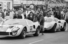 Karl Schmid and volunteers push the Chaparral 2D to its starting position at Le Mans, June 1966. If you look carefully, you'll notice that the 2D is wearing rain tires. Rain was expected for the race start, but never happened. Thus, the 2D started with unsuitable tires and was unable to turn its best lap times. Max Le Grand photo.