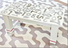 #Upcycle your worn out coffee table using house numbers and ProBond Advanced. Then cover the top with a piece of acrylic and you're done! #DIY