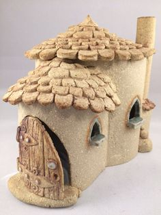 This cottage will make an excellent home for any fairy family looking for a house.  Hand-built of stoneware ceramic, frost proof and suitable to stay in the garden all year round. After building, it was aloud to dry out, cleaned, and fired for the first time. Oxides and a little glaze are applied, then it is fired for a second time, this time going to 1260 degrees centigrade. At this temperature the clay becomes vitrified, which means the clay body is no longer poras. It can not absorb…