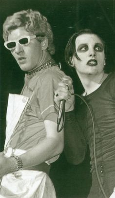 i have no idea who these people are but i love the theater ... and the white 3D-ish glasses    Captain Sensible and Dave Vanian