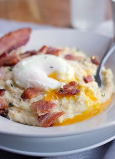 Creamy Breakfast Polenta with Asiago, Thyme, Bacon, and Poached Eggs- Polenta is a hearty porridge made from  flnt corn and other ingredients. Baker Bettie